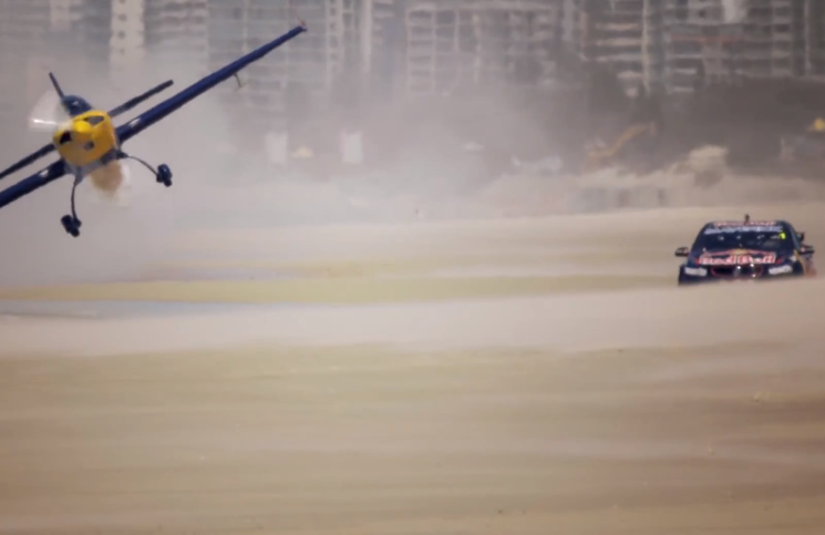 Red Bull V8 supercar vs stunt plane